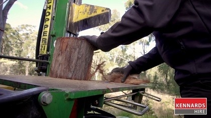 Split the halves of the log three or four times to get smaller pieces of firewood.